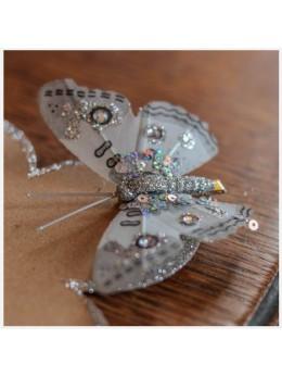 Papillons sur pince pailletté argent
